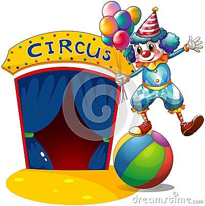 Een clown met ballons die boven een bal in evenwicht brengen