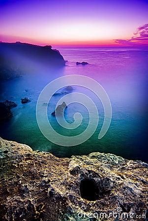 Eerie sunrise over sea