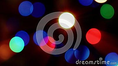 Efeito movente borrado de Bokeh das luzes do sumário Árvore de Natal fundo 4K video estoque