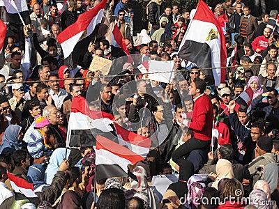 Egípcios que chamam para a renúncia de Mubarak Imagem Editorial