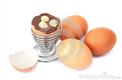 Egg with chocolate surprise and hazelnuts