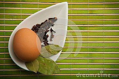 Egg and laurel leaves