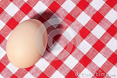 Egg on picnic tablecloth