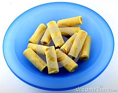 Egg rolls on blue plate