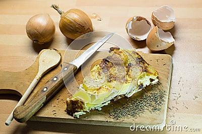 Egg tortilla on cutting board