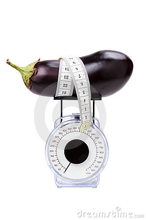Eggplant with measuring tape on kitchen scale