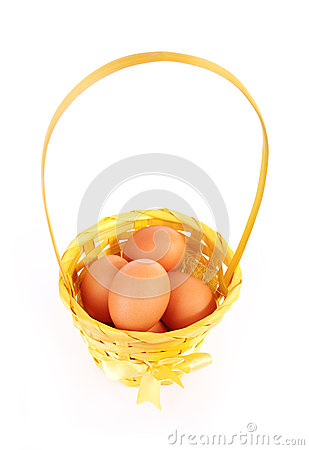Eggs in beautiful basket isolated on white