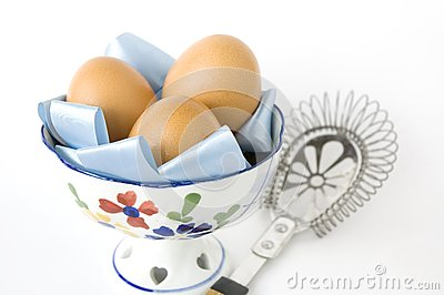 Eggs in bowl with kitchenware