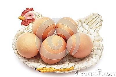 Eggs on decorative hen nest