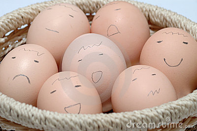 Eggs with Faces in Basket