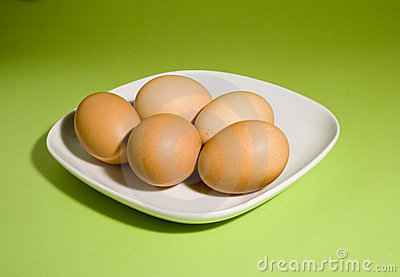 Eggs on fresh green background