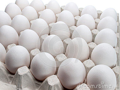 Eggs of a hen in packing on a white background.