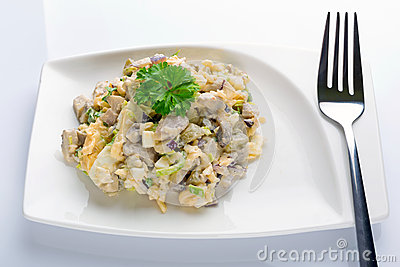 Eggs and mushrooms salad with leek and red onion