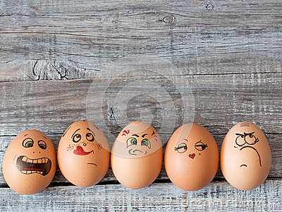 Eggs with painted faces. Photo for your design. Concept of joint Stock Photo