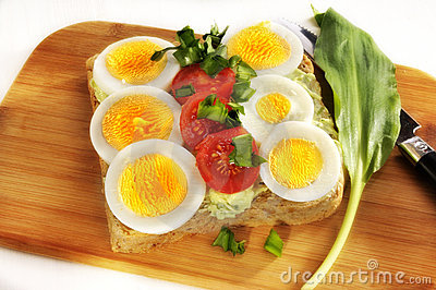 Eggs and tomatoes on bread