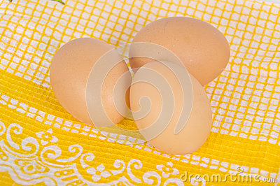 Eggs on yellow tablecloth