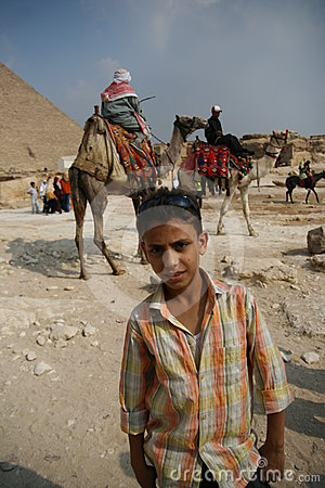 Egypt teenage and the camel riders Editorial Stock Image