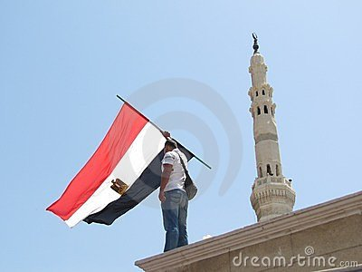 Egyptian demonstrator holding flag Editorial Photography