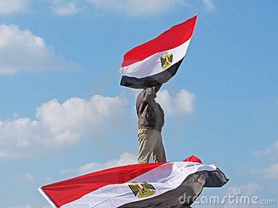 Egyptian demonstrator holding flag Editorial Stock Image