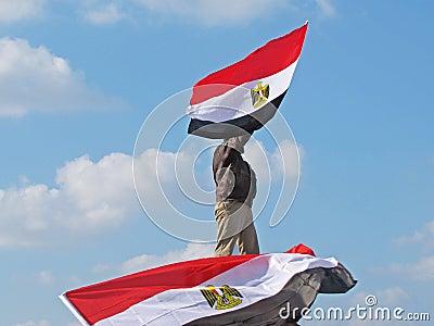 Egyptian demonstrator holding flag Editorial Stock Image