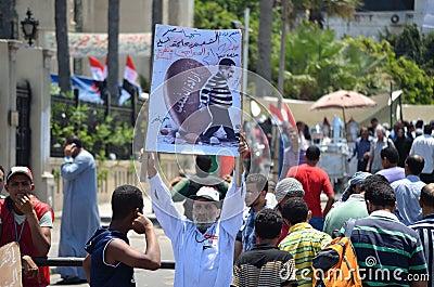 Egyptian demonstrator holding sign Editorial Image