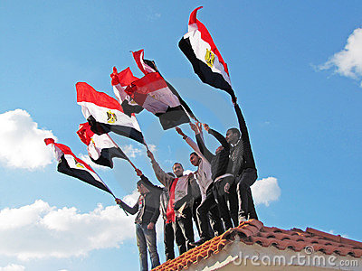 Egyptian demostrators waving flags Editorial Image