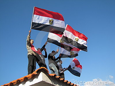 Egyptian demostrators waving flags Editorial Photo