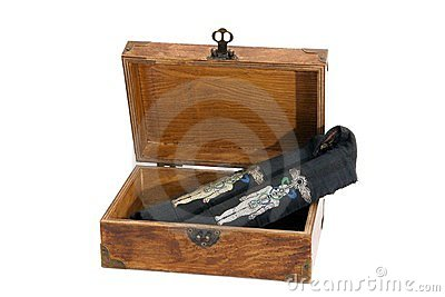 Egyptian healing wands in a wooden box