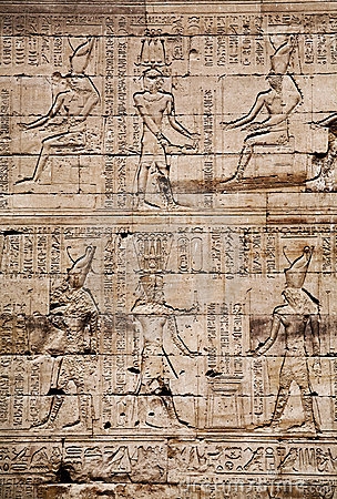 Egyptian images and hieroglyphs engraved on stone