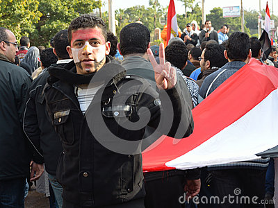 Egyptian protestor flash victory sign Editorial Photo