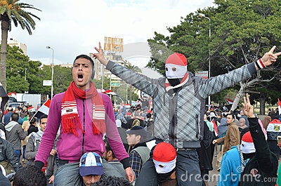 Egyptian protestor flash victory sign Editorial Photography