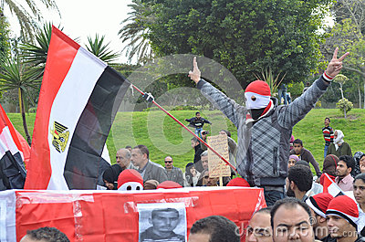 Egyptian protestor flash victory sign Editorial Image