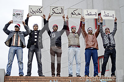 Egyptian protestors holding protest signs Editorial Image