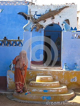 Egyptian woman sweeping at Aswan. Egypt Editorial Photography