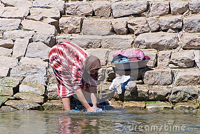 Egyptian woman washing clothes Editorial Stock Image