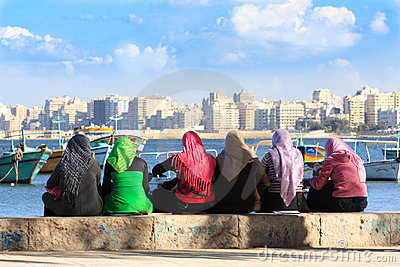 Egyptian women in colorful headscarves
