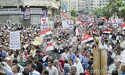 Egyptians demonstrating against Military Council Editorial Stock Photo