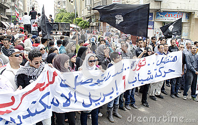 Egyptians demonstrating against Military Council Editorial Photo