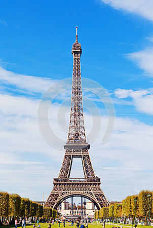 Eiffel Tower against the blue sky and clouds Editorial Photography