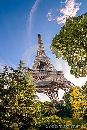 Free Eiffel Tower Among The Trees In Summer Time. Stock Images - 96056424
