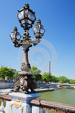 Eiffel Tower and bridge on Seine river in Paris, Fance.
