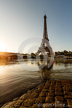 Eiffel Tower and Cobbled Embankment of Seine River at Sunrise