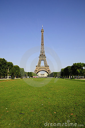 Eiffel tower and green meadow