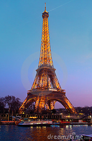 Eiffel Tower illuminated at night. Editorial Stock Image