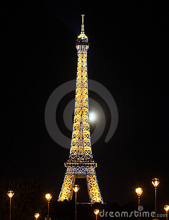 Eiffel tower at night with moon behind Editorial Stock Image