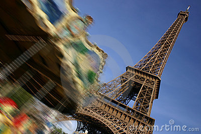 Eiffel tower, Paris, and moving merry-go-round