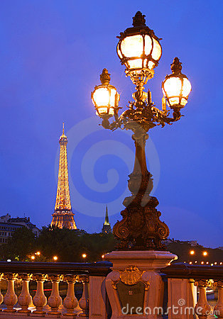 The Eiffel Tower in Paris at night Editorial Image