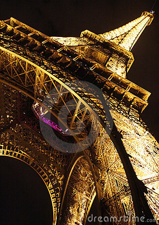 Eiffel tower in Paris by night, closeup diagonal Editorial Stock Photo