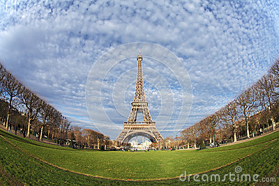 Eiffel Tower in Paris on the winter with the white clouds