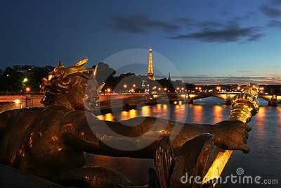 Eiffel Tower and sculpture on the bridge in Paris. Editorial Stock Image